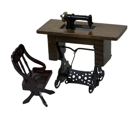 Antique table sewing machine with a foot pedal and chair - path included Stock fotó