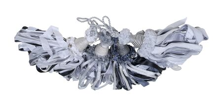 Several Decorative black and white tassels with bells and cords - path included
