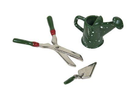 Gieter en scheren en troffel voor het werken in de tuin - pad opgenomen
