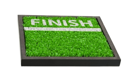 Finish line and word drawn onto green grass to show that it is the finish line on the field Stock Photo