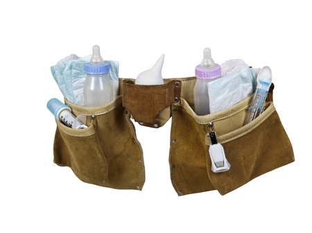 tool bag: Baby items filling a leather tool belt for carrying items conveniently while working - path included