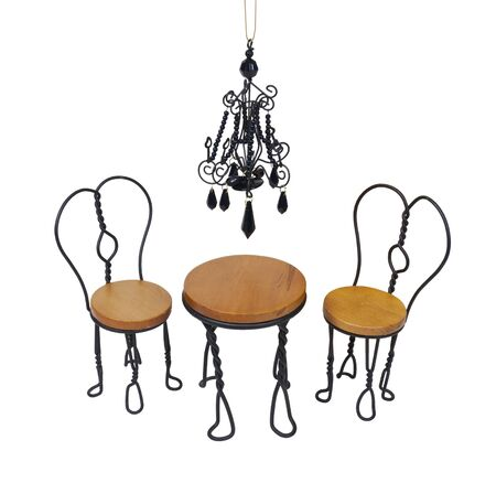 comfortable chair: Black chandelier with black crystals hanging down over a bistro setting of chairs and table - path included
