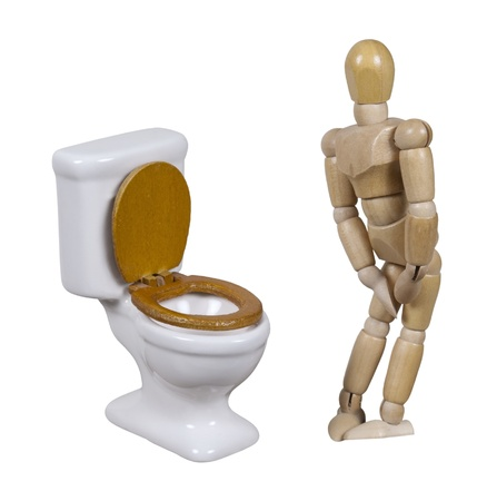 Model in need to relieve himself next to a porcelain toilet with wooden seat - path included