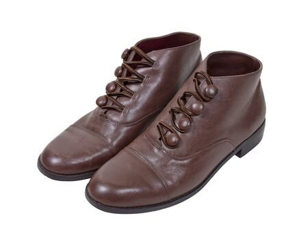 Vintage feminine brown leather shoes with button clasps - path included Stock Photo - 11771821