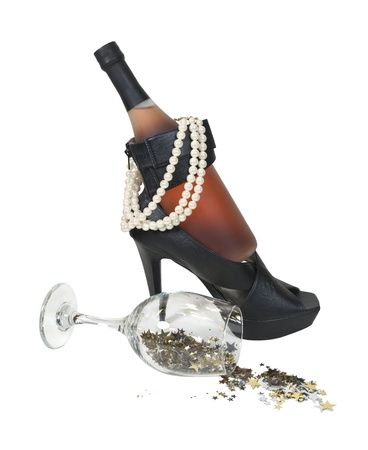 Wine bottle in high heel shoes with pearls and stars spilling from glass - path included