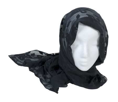 Wearing a black lacey scarf with delicate details wrapped around the head - path included