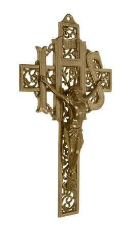 A brass cross representing a crucifix which is a Catholic symbol of their savior on a cross  included