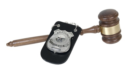 Silver special police badge with a star and a Wooden Gavel Stock Photo