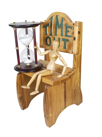 Waiting Out Time in Time Out Chair Holding Hour Glass