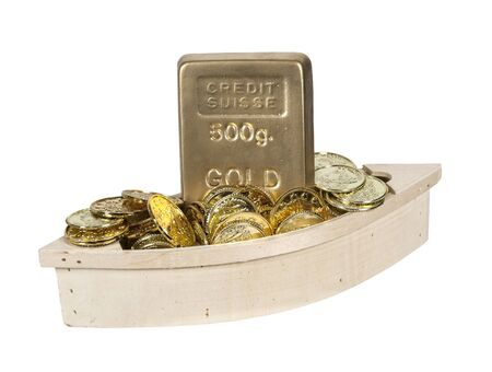 booty pirate: Wooden boat filled with gold coins and gold bars Stock Photo