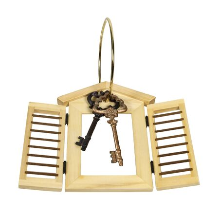 Wooden shutters of a home on a key ring with vintage keys