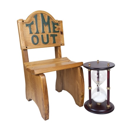 Hour glass used to measure time next to a time out chair