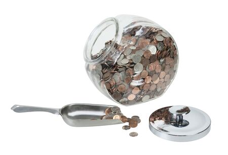 Large glass jar with lid full of coins with a scoop in the opening Stock Photo - 16210582