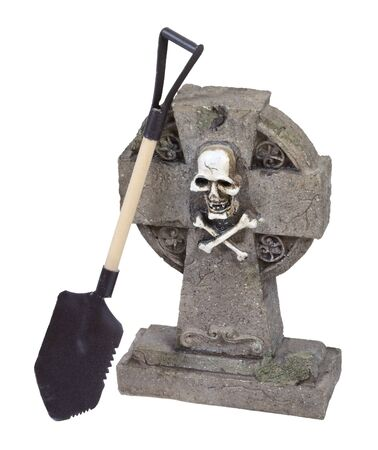 Shovel next to a headstone in a cemetery  photo