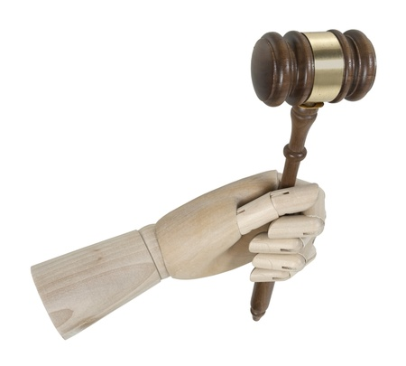 Wooden hand holding a ceremonial wooden gavel  Stock Photo
