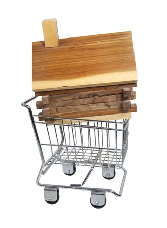 log basket: Wooden log cabin made of wooden planks and beams in a shopping cart Stock Photo