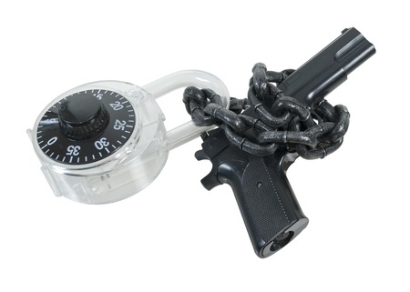 Black hand gun wrapped in large chain locked with a padlock - path included