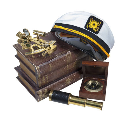 Boating Books Captain Hat Brass Sextant Telescope - path included Stock Photo