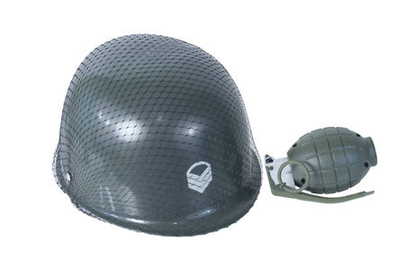 Green military helmet with netting over it and grenade - path included
