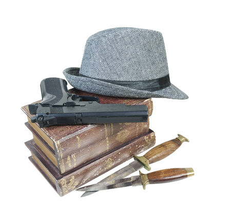 Murder mystery books with gun, knives and fedora hat - path included