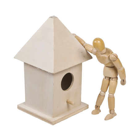 Person peering into a birdhouse with Roof and a Peg for a Porch - path included Stok Fotoğraf
