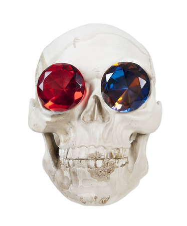 Skull with teeth and gems in the eye sockets - path included Stock Photo