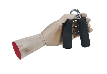 grasp: Wooden hand gripping a hand grip exercisers used to strengthen hand muscles - path included
