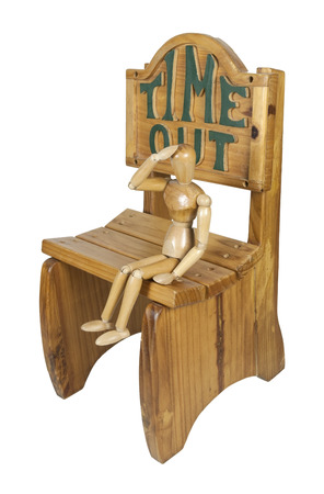 wrongdoing: Sitting in timeout in a time out wooden chair - path included