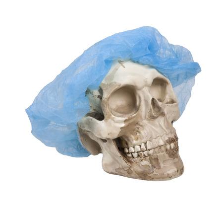Skull with eye sockets and teeth wearing a medical hair net