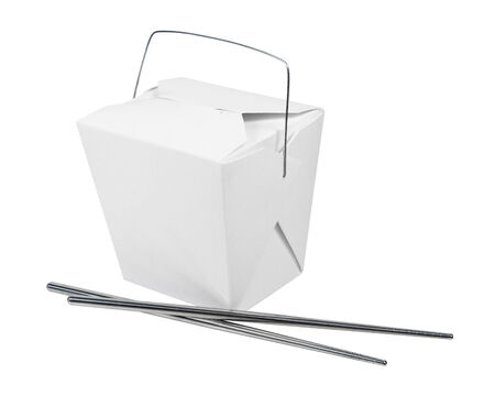 A wax paper box that is folded up to hold take out food items with metal chopsticks