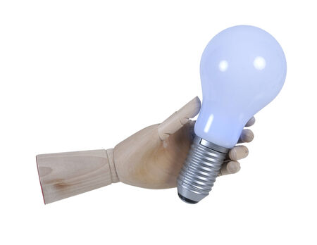 grasp: Wooden Hand Holding Lightbulb that displays light - path included Stock Photo