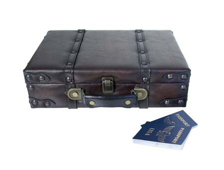 attache: Small vintage briefcase to carry clothing and essentials when traveling with passports - path included