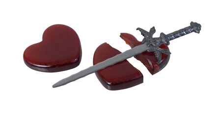 path to romance: Sword and a Broken Red glass heart symbolizing a broken heart over a failed romance - path included Stock Photo