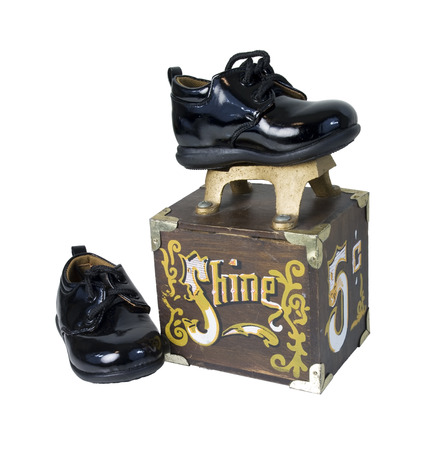 Black shiny shoes on a Vintage shoe shine box used to manually polish formal shoes - path included