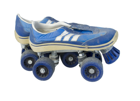 tennis shoe: Old beat up tennis shoe roller skates - path included Stock Photo