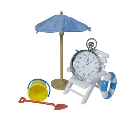 time off: Stop watch relaxing in chair next to umbrella with beach toys to show timing time off - path included Stock Photo