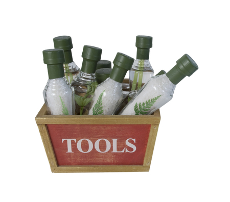 Cone Shaped bottles that contain bath salts in a Tool Box to show the proper tools for a relaxing bath - path included