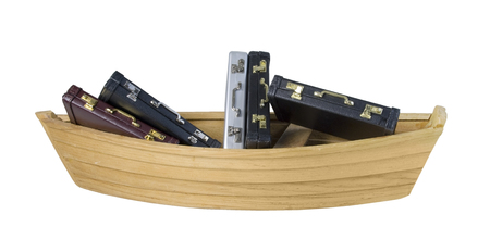 used items: Wooden boat filled with Leather briefcase used to carry items to the office - path included Stock Photo