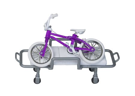 gurney: Bicycle laying on a hospital gurney to show that injuries can occur - path included
