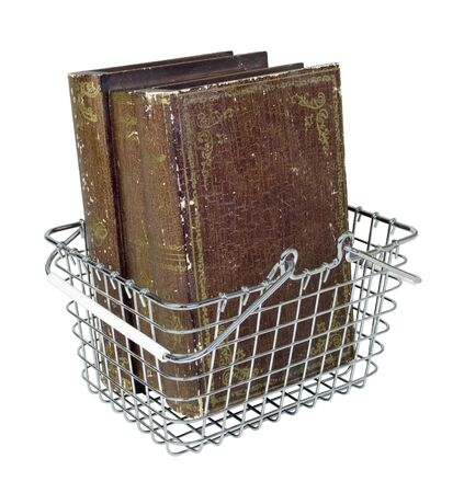 Shopping basket filled with vintage old books - path included