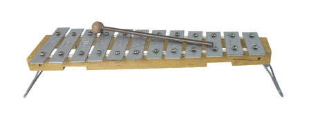 Xylophone instrument which is played by striking the different metal plates with a striker - path included 版權商用圖片
