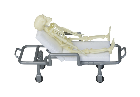A skeleton laying out on a gurney - path included