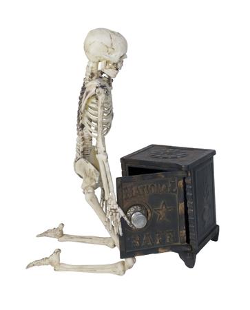 Skelet met een kluis gebruikt om effecten en geld op te slaan - pad inbegrepen