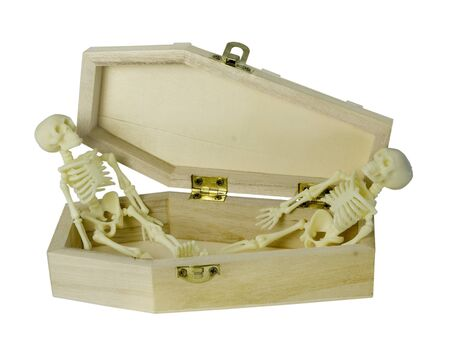 Two skeletons in a Coffin facing each other - path included Stockfoto