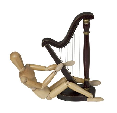 Playing a harp, which is a stringed musical instrument - path included