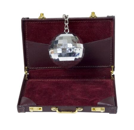 Disco ball that reflects the lights back into the room in a leather briefcase - path included