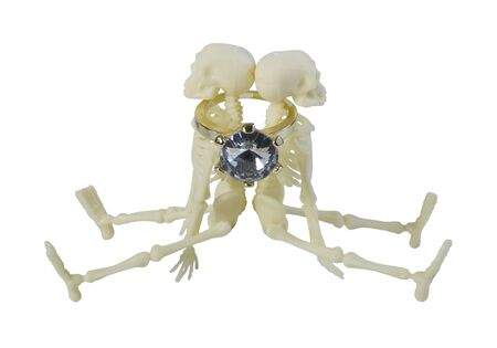 Gold diamond engagement ring around the neck of two Skeletons - path included