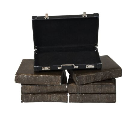 Briefcase on a stack of old books - path included