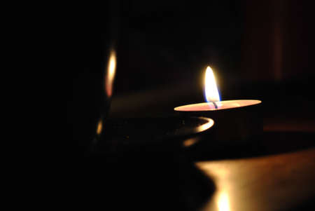Alight candle with cup in the dark, photo photo
