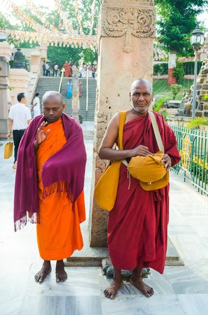 BODHIGAYA, INDIA - MAY 13, 2014:  Unknow monks  stand for charity around Mahabodhigaya temple where buddha got enlightment on 13 May 2014